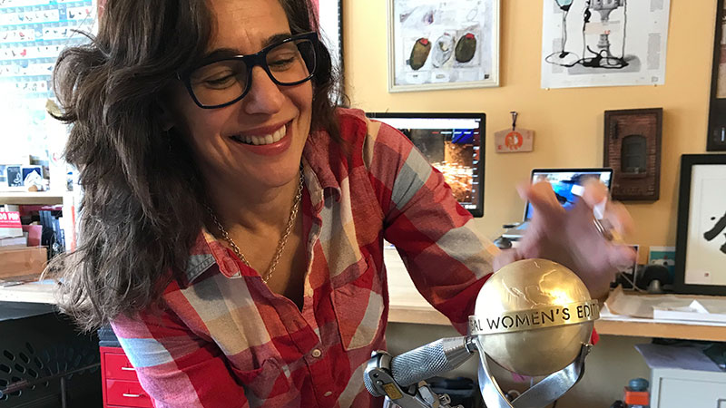 Trophy designer Lisa Issenberg smiling while making the trophy.